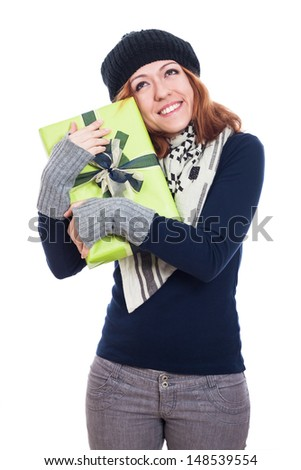 Satisfied happy winter woman holding present, isolated on white background. - stock photo