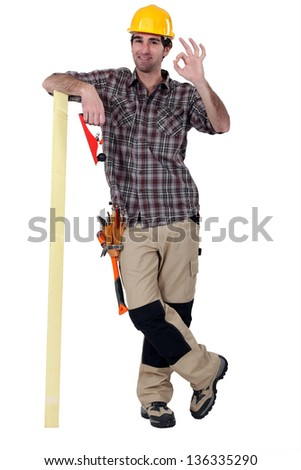Satisfied laborer doing OK sign