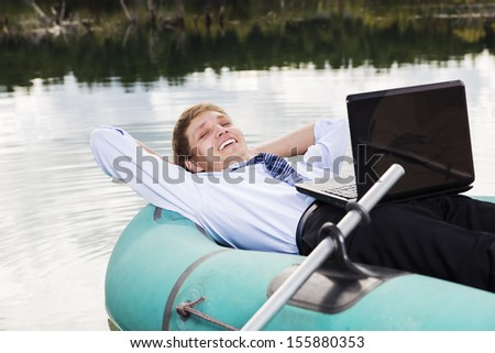 Satisfied man lay in boat and take time