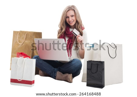 Satisfied shopping woman using credit or debit card to buy online. E-payment concept on white background - stock photo