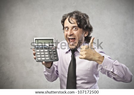Satisfied smiling businessman showing a calculator