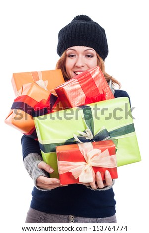 Satisfied woman in winter hat holding many presents, isolated on white background. - stock photo