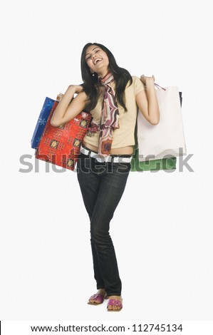 Satisfied woman posing with shopping bags