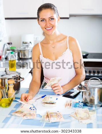 Satisfied young female received interest on deposits - stock photo