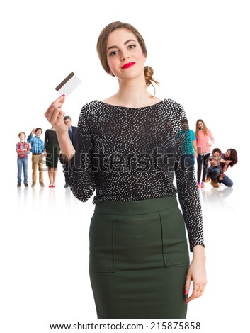 Satisfied young girl holding a credit card - stock photo