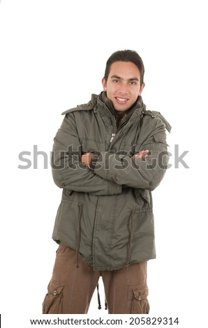 satisfied young man wearing green jacket posing crossing arms isolated over white - stock photo