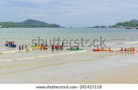 SATTAHEEP CHONBURI -MAY,25:The group of tourists have activities on the beach . They enjoy playing and swimming  .THAILAND MAY,25 2015
