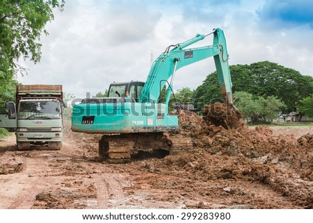 SATTAHIP CHONBURI - July,23 : Backhoe on the construction at digging the pit. Preparatory work for the construction of grain silos. The work of construction machinery in a quarry.THAILAND JULY,23 2015 - stock photo