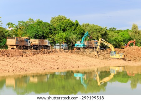 SATTAHIP CHONBURI - JULY,23 : Construction site at digging the pit. Preparatory work for the construction of grain silos. The work of construction machinery in a quarry.THAILAND JULY,23 2015 - stock photo