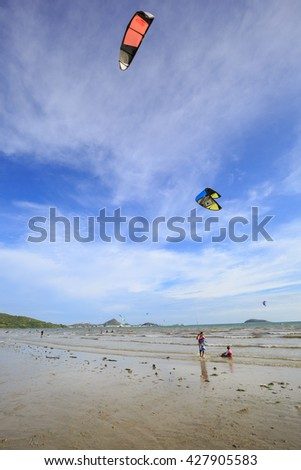 SATTAHIP CHONBURI - MAY,29 : The kite surfer is sport player in competition Event Thailand Championship . This is the nice view kite surfing on the beach. THAILAND MAY,29 2016