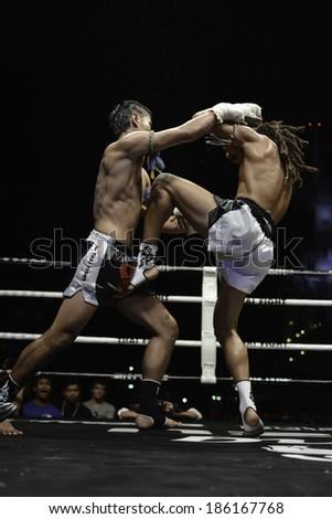 SATTAHIP, THAILAND- APRIL 6 : Between the punch  in Thai Fight : Muay Thai..World's  between Sudsakorn Sor.Klinmee VS Cody Moberly on April 6, 2014 at King of muay thai , Chonburi , Thailand - stock photo