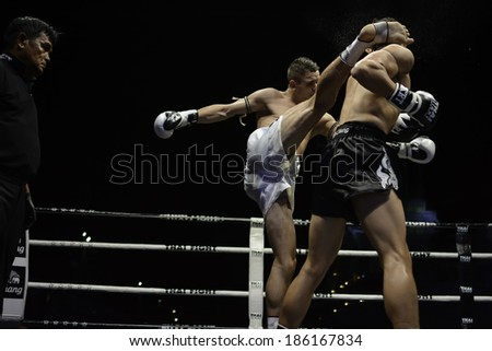 SATTAHIP, THAILAND- APRIL 6 : Between the punch  in Thai Fight : Muay Thai..World's  between Antoine Pinto (France) VS Alan Ryan (Scotland)  on April 6, 2014 at King of muay thai , Chonburi , Thailand
