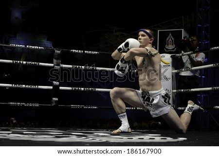 SATTAHIP, THAILAND- APRIL 6 : Between the punch  in Thai Fight : Muay Thai..World's  between Leo Pinto (France) VS Cody Moberly (USA) on April 6, 2014 at King of muay thai , Chonburi , Thailand  - stock photo