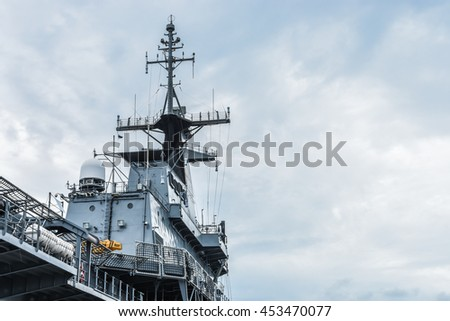SATTAHIP, THAILAND - JULY 10 2016: HTMS Chakri Naruebet aircraft carrier at Juksamet Port Sattahip. The port is one of the few deep-water ports of Thailand for Naval base and commercial ships.
