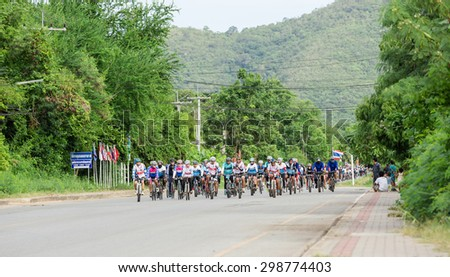 "SATTAHIP,THAILAND - JULY 19 : Two cyclists are pedaling inside Sattahip Naval base area in ""Tour of Sattahip 15"" tournament racing in range 50,100 Kms. on July 19,2015"