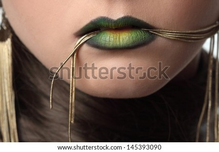 saturated lip art makeup with decoration - stock photo