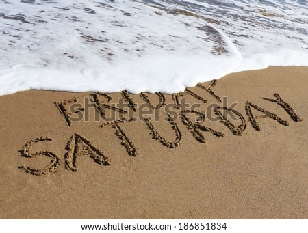 Saturday is coming concept - inscription Friday and Saturday written on a sandy beach, the wave is starting to cover the word Friday.  - stock photo