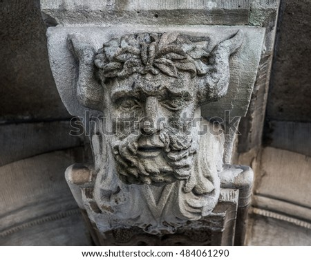 Satyr head decoration above door
