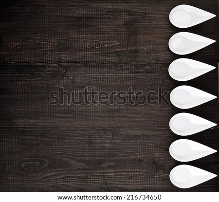 Sauce boat on black wooden rustic surface background top view - stock photo