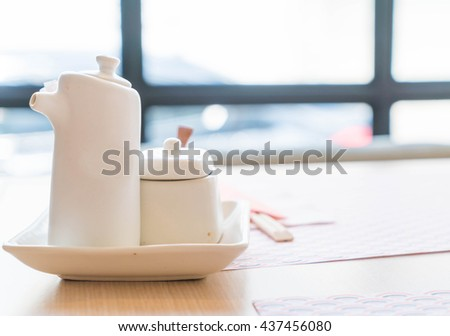 sauce bottle on table in restaurant - japanese style - stock photo