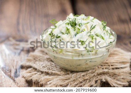 Sauce Remoulade (homemade) with fresh herbs on wooden background - stock photo