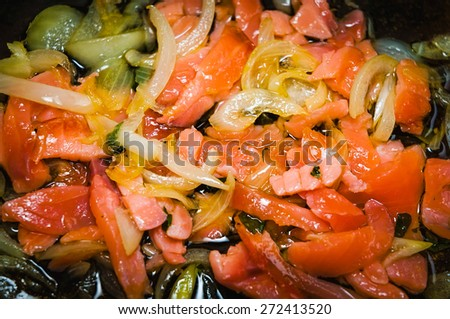 Sauce with salmon, tomato and onion for italian pasta, in a pan - stock photo