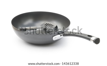 saucepan and spatula on white