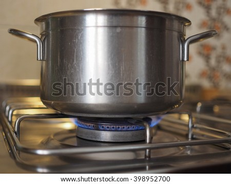 Saucepan on a gas cooker in kitchen