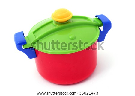 saucepan with lid isolated on white. Child plastic pot cooking toy - stock photo