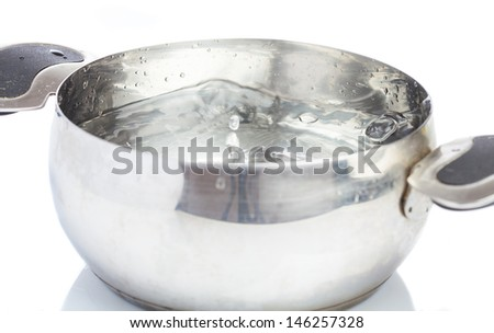 saucepan with water boiling on white background - stock photo
