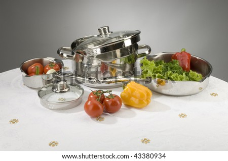 Saucepans with products - stock photo