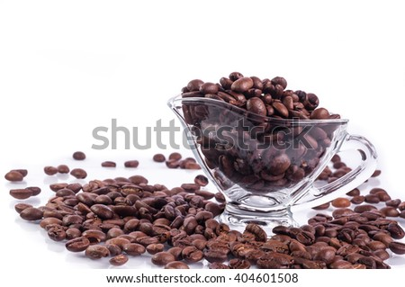 saucers filled with coffee beans - stock photo