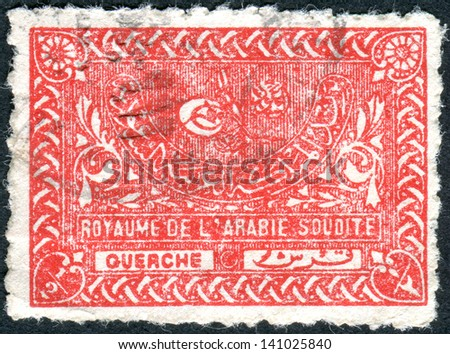 SAUDI ARABIA - CIRCA 1943: Postage stamp printed in Saudi Arabia shows the Tughra of King Abdul Aziz, circa 1943 - stock photo