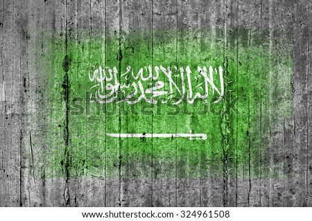 Saudi Arabia flag painted on background texture gray concrete - stock photo