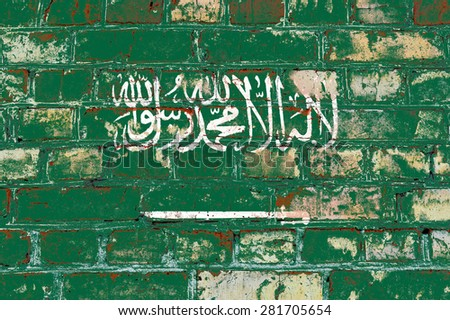 Saudi Arabia flag painted on old brick wall texture background - stock photo