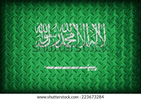 Saudi Arabia flag pattern on the diamond metal plate texture ,vintage style - stock photo