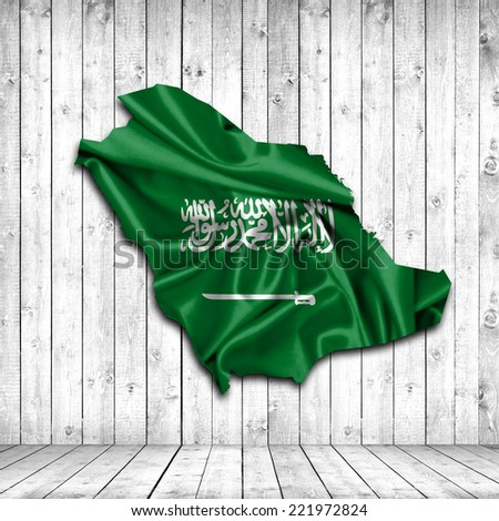 Saudi Arabia map of fabric and wood background