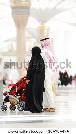 Saudi Arabian family walking - stock photo