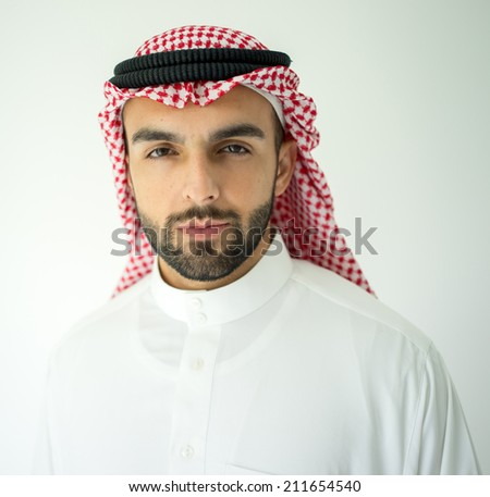 Saudi Arabian young businessman posing - stock photo