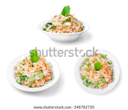sauerkraut is on the plate on white background - stock photo