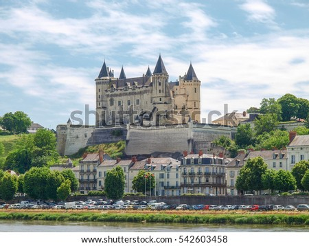 Saumur, France - June 10, 2014: Castle and town of Saumur by the Loire River in the landscape