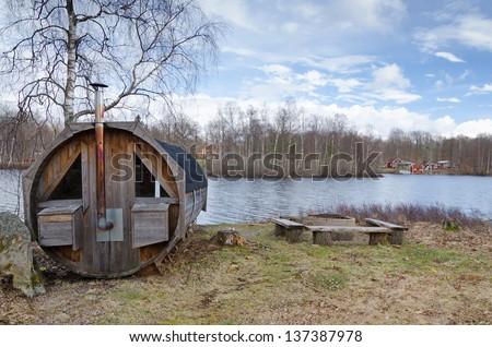 Sauna house on a lake coast - stock photo