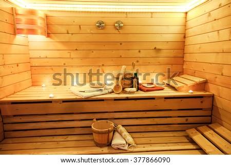 Sauna room with traditional sauna accessories - stock photo