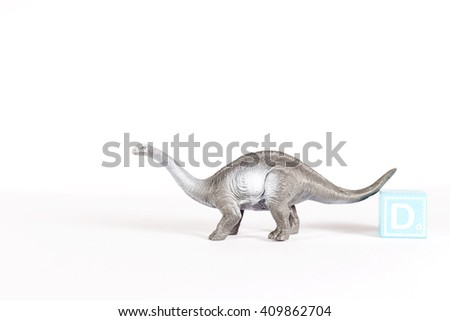 Sauropod walking on the white background with word block. - stock photo