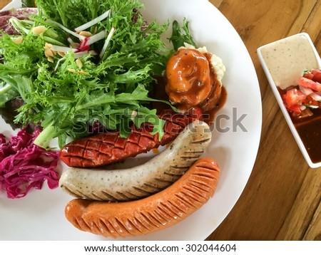 sausage and mashed potato salad with dips - stock photo