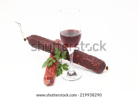 sausage and parsley with a glass of wine on a white background - stock photo