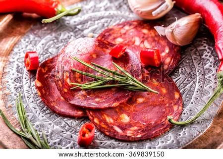 Sausage Chorizo. Spanish traditional chorizo sausage, with fresh herbs, garlic, pepper and chili peppers. Traditional cuisine. - stock photo