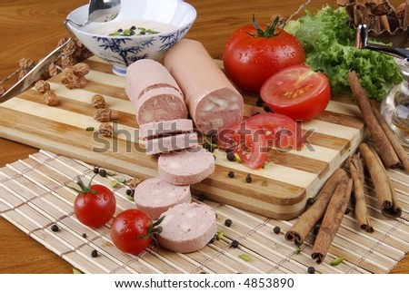 sausage ON on a wooden table with tomato