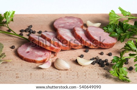 sausage on wooden table & white backgraund
