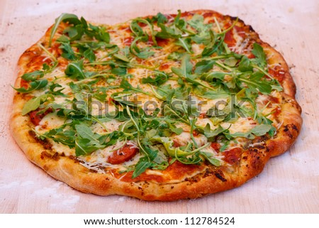 Sausage Pizza with Arugala - stock photo
